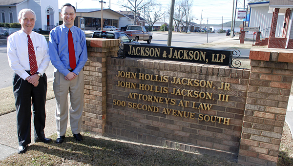 John Hollis Jackson and Hollis Jackson in front of their law office in Clanton.