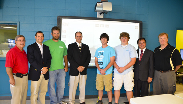 Attending the Cawaco RC&D grant presentation at LeCroy Career Technical Center's STEM Academy were (left to right): Industrial Development Coordinator Fred Crawford, Drayton Cosby of The Cosby Company, STEM instructor Jason Sosa, Rep. Kurt Wallace, students Colby Ramsey and Jacob Smith, LeCroy director Tommy Glasscock and STEM instructor Jay LeCroy.