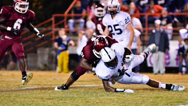 Maplesville's Devonte' Morrow tackles Jemison's Keyshawn Jemison during Thursday's game.