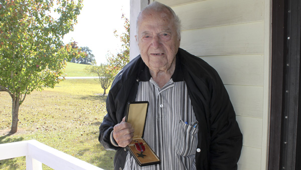 Forest Elmore, 91, enlisted in the United States Army on Dec. 7, 1940, shortly after he turned 18 years old.