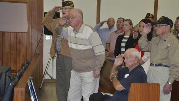 Chilton County veterans were honored for their service at a special ceremony Monday morning at the Chilton County Courthouse. A group of veterans (pictured) sing the National Anthem during the ceremony.