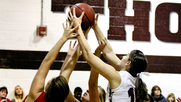 Up for grabs: Thorsby's Sabrina Ellison (15) fights with Verbena's Makaylie Kelley (3) and Alyssa Evans for the basketball during Tuesday's game.