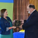 SPAN Program coordinator Amanda Hicks presents Randy Strattis with a plaque of appreciation for his service to the SPAN Program of Chilton County.