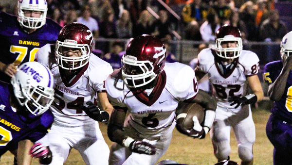 Running Red Devil: Maplesville's Damian Mitchell (6) rushed 14 times for 105 yards and two touchdowns in Friday's second-round playoff win at Geneva County.
