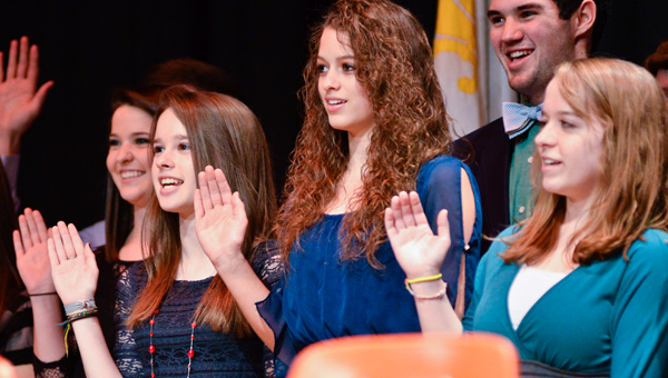 New members of the Chilton County High School National Honor Society recite the organization's pledge during an induction ceremony Friday held in the school's auditorium.