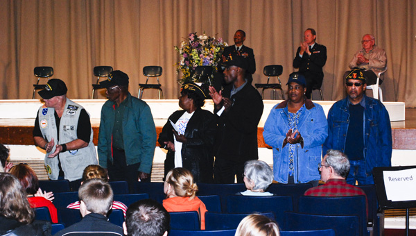 Local veterans stand as they are applauded for their military service at Verbena High School's Veterans Day Ceremony on Friday.