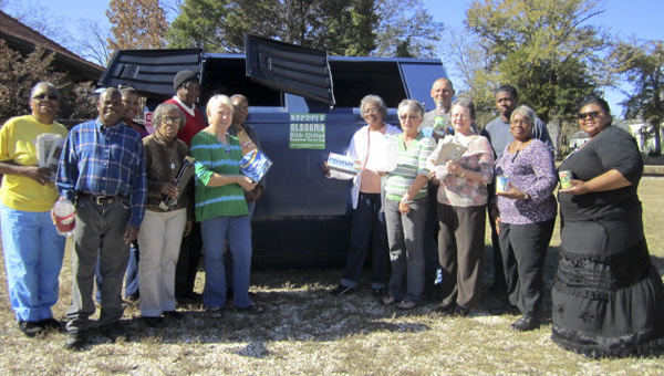 Maplesville Seniors and Town officials add paper, plastic, metal and aluminum and cardboard  to the new recycling bin located next to the train station. The recyclables are transported to the Bibb County Correctional Facility for sorting.   Participating were l-r: Flora Lee, James Ware, Tondia Harrell, Rosa Harvell, Alma Shields,  Nell Champion, Ethel Davis, Carolyn Melton, Faye Hightower, Senior Center Manager; Kenny Barrett from the Street and Garbage Dept; Sheila Haigler, Town Clerk; Darrell Goodwin from Street and Garbage Dept; Carrie Howard, and Tera Harrell.