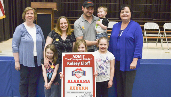 Jemison Elementary School second grader Kelsey Eloff won three tickets to the Iron Bowl after participating in a reading contest. Third grade teacher Susan Daniels, Sarah and Charlie Eloff and Molly, Zoe and Connor along with Jemison Elementary Principal Louise Pitts stand next to Eloff (center) after a surprise school assembly on Friday.