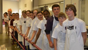 The morning of the meal, members of the student council (pictured) donned aprons, hairnets and gloves and served more than 800 students.