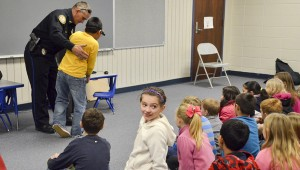 """Jemison Police Department Deputy Chief Marc McMinn spoke to a group of students Tuesday morning about the police department. McMinn brought a """"special"""" set of goggles designed to show the dangers of drinking and driving."""