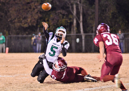 Maplesville defender William Harrison pulls down Brantley quarterback Wesley Person as he tries to get off a pass.