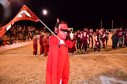 Maplesville's Red Devil mascot celebrates with players and fans after the game.