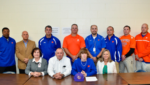 Chilton County High School baseball player J.D. Minor (seated, third from left) was joined at a signing ceremony Wednesday by CCHS coaches and administrators as well as parents Tim and Sherry Minor.