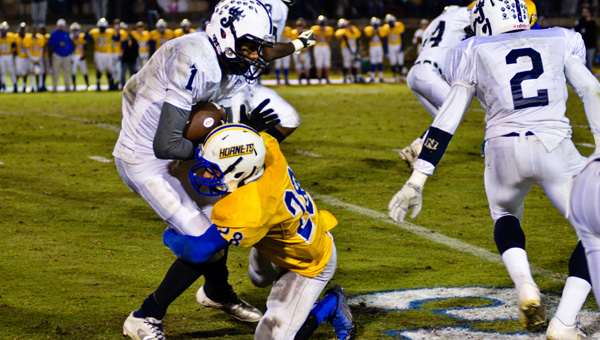 Standing in their way: Randy Satterfield (1) and his Jemison teammates ran into a roadblock Friday in the form of Mike McDonald and Beauregard.