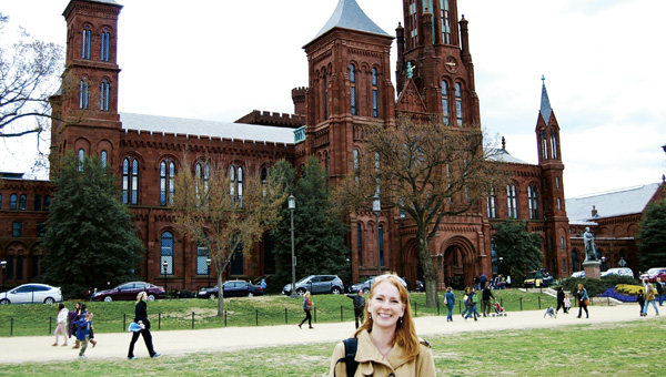 Sarah Jackson stands in front of the Smithsonian's Castle building in Washington, D.C., where one of her award-winning photographs was displayed this past year.