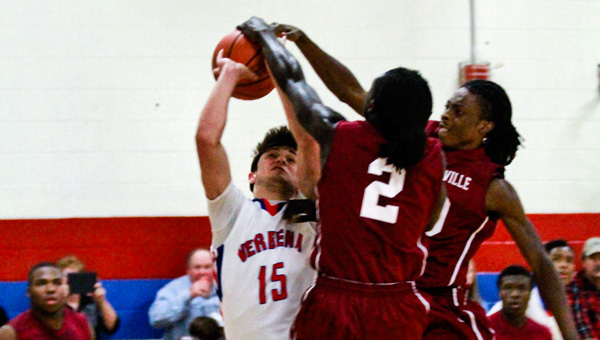 Verbena's Jared Mims (15) has his shot blocked by Maplesville's Stevonta Bradley (2) and Kendarius Bradley during Thursday's game.