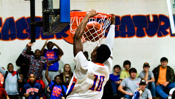 Chilton County's Braylen Parker dunks for two of his 11 points in Friday's win over Shelby County.