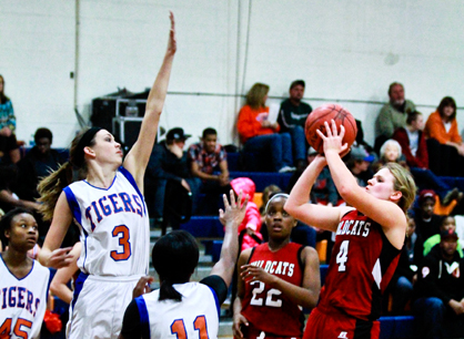 Shelby County's Marjorie Head (4) tries to shoot over the defense of Chilton County's Gabriel Kelley.
