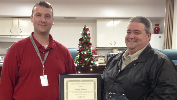 Chilton County E-911 Director Dan Wright (left) presents Shelby Ellison with the Dispatcher of the Year award on Tuesday.