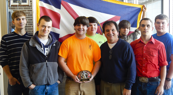 Casey Cook, a 19-year-old senior at Maplesville, holds his 2013 Firefighter of the Year award from the Jones Volunteer Fire Department in Autauga County. Cook, a student in the Public Service Academy at LeCroy Career Technical Center, is pictured with LeCroy Director Tommy Glasscock and fellow PSA classmates.