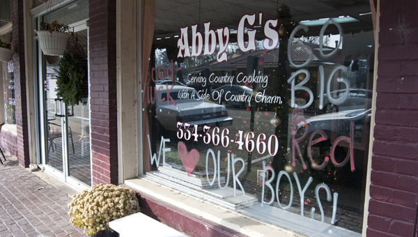 Maplesville High School cheerleaders painted the windows at Abby G's Cafe and other businesses in Maplesville to support the varsity football team in the state championship Dec. 5.