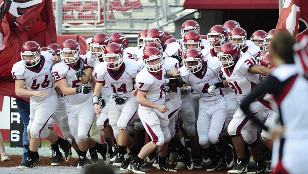 The Maplesville Red Devils run out of the tunnel at Bryant-Denny Stadium before facing Pickens County in the football Class 1A state championship Dec. 5. The Red Devils fell to the Tornadoes, 38-18.