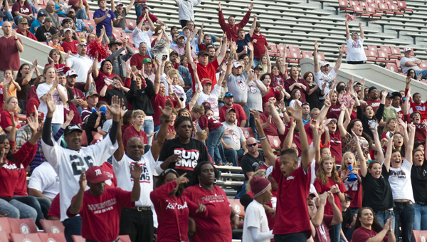 Maplesville fans cheer as the Red Devils score a touchdown against the Pickens County Tornadoes in the football Class 1A state championship Thursday at Bryant-Denny Stadium in Tuscaloosa.