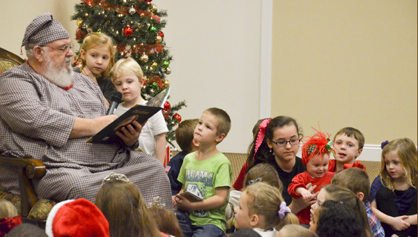"""Long-time Jemison resident Tracy Cobb dressed up as """"grandpa"""" and read """"The Night Before Christmas"""" to children at the annual Jemison tree lighting event on Thursday."""