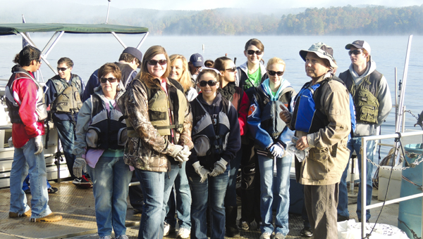 Volunteers prepare to help remove debris from Lake Mitchell at the annual Renew Our Rivers cleanup event Nov. 2.