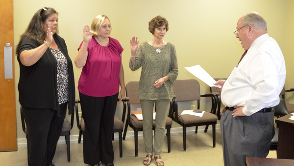 Pam Kelley, Michelle Bolton and Sherry Cox were sworn into office for the Chilton County Board of Registrars for the next four years by Chilton County Probate Judge Bobby Martin on Wednesday. (Photo by Emily Reed)