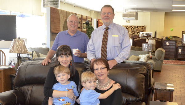 John and Linda Klinner (right) help celebrate 90 years of business with their family including son-in-law and daughter Doug and Shelley Hamilton (left) and two grandchildren, J.D. and Miller Hamilton.