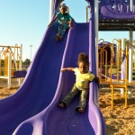 Sliding down: Zayauna Brown and Mikhia Wright enjoy new playground equipment installed recently at E.M. Henry Park. (Photos by Stephen Dawkins)