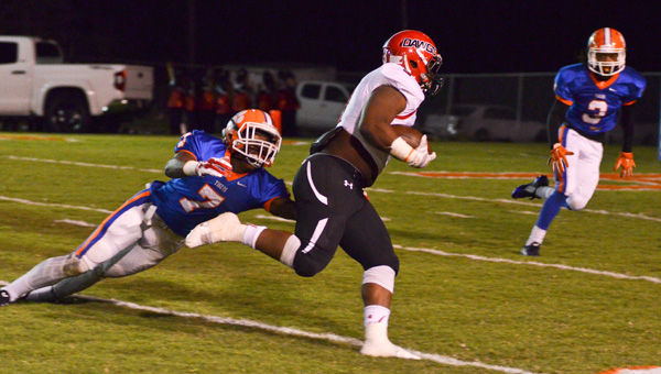Slipping by: Chilton County's Giquan Lane (left) is unable to tackle a Opelika ballcarrier on Friday. (Photo by Stephen Dawkins)