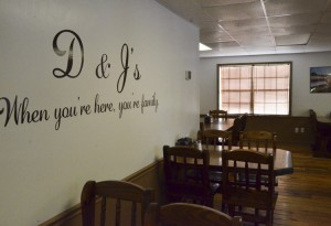 A wall inside the restaurant reminds customers that D&J's Café owners want them to feel like family when they visit.