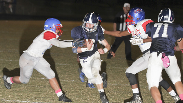 Panther quarterback Phillip Lenoir goes in from three yards out for one of his six rushing touchdowns.
