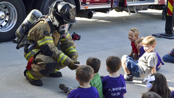 Clanton Fire Department firefighter Paul Shearon shakes hands with preschoolers who visited the Clanton Fire Department on Tuesday. Children ages 2-4 from Clanton First Baptist Church's preschool took part in the program's annual Community Helpers Week. (Photos by Emily Reed)
