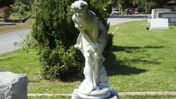 The Italian marble statue of a muse that marked the grave of Mary Jo McGowin Patterson, wife of former Governor John Patterson, was anonymously returned Tuesday after allegedly being stolen.