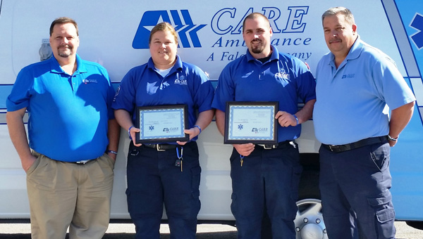 Service recognized: CARE Ambulance paramedic Michelle Glass (second from left) and EMT Mitch Keener (third from left) received awards Friday and are pictured with Operations Manager Dewayne Watley and Vice President Kevin Harralson. (Contributed photo)