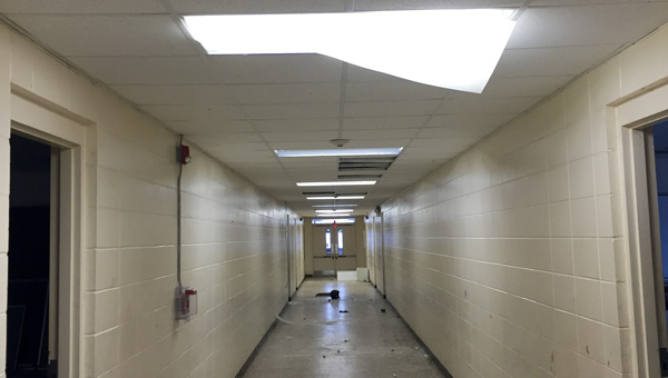Light fixtures located in the hallways at JHS were shattered with bricks. (Contributed)