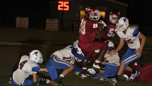 Terence Dunlap gets spun around while trying to reach the end zone. (Photo by Brandon Sumrall)