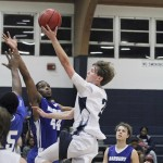 Jemison's Wesley McGehee (No. 2) has his sights on a score as he flies down the lane. (Photos by Brandon Sumrall)