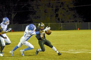 Derrick Dunigan runs through a tackler as he fights for extra yards on the ground.