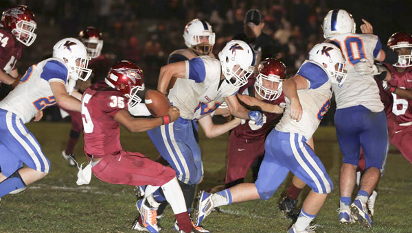 Maplesville's Timothy Bradley (No. 35) strips the football from a Kinston ball carrier earlier in the playoffs. (File Photo)