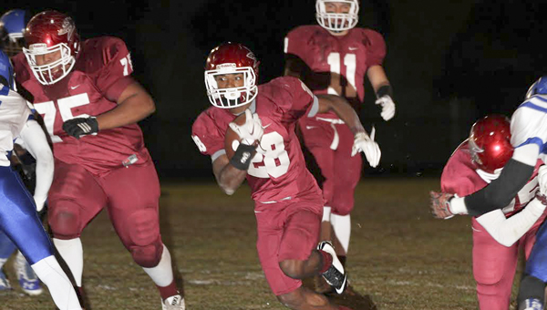 Terence Dunlap (No. 28) runs for yards behind Tyrone Davis (No. 75) and the rest of the offensive line. (Photo by Brandon Sumrall)