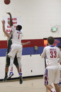 Juwan Tyus (No. 1) uses his size to shoot over a Shades Mountain Christian defender. (Contributed)