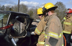 Nathan Bland and Bryant Baker practiced how to quickly remove an individual from a vehicle during an emergency situation.