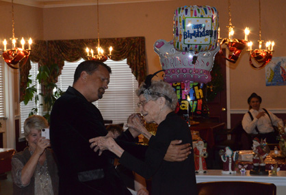 Just dance: Kay Miller (right) celebrates her 102nd birthday by dancing on Friday with Sterling Burroughs from Champion Latin and Ballroom in Vestavia Hills.