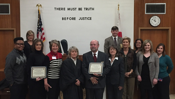 Teamwork: Representatives from the 19th Judicial Circuit and the Chilton County Department of Human Resources who were recognized include: Shaun Nix, Amber Darnell, Tamela Minor, Marilyn Colson, Judge Rhonda Hardesty, District Attorney Randall Houston, Marsha Scott, C.J. Robinson, Referee Tina Moon, Beverly Parker, Jacren Scarbrough and Alisha McDonald. (Contributed photo)