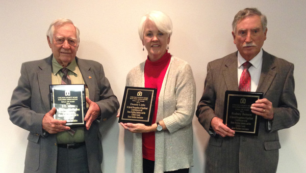Making their mark: The first inductees of the Chilton County Home Builders Association's Hall of Fame were J.O. Mims (left), Donnie Little (award accepted posthumously by his wife Needra Little, center) and Rodney Benson. (Photo by Leisl Lemire)