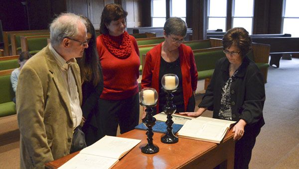 Tom Turley (left) and Becky Hebert from the Alabama Department of Archives visited Chestnut Creek Baptist Church on Tuesday to meet with members of Chestnut Creek Heritage Chapel including Pam Persons, Ola Taylor and Denise Scarbrough. The group is pictured looking at church financial records.